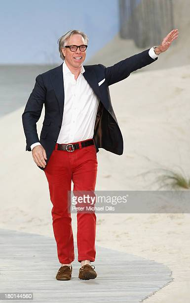 Designer Tommy Hilfiger takes a bow on the runway at the Tommy Hilfiger Women's fashion show during MercedesBenz Fashion Week Spring 2014 on...
