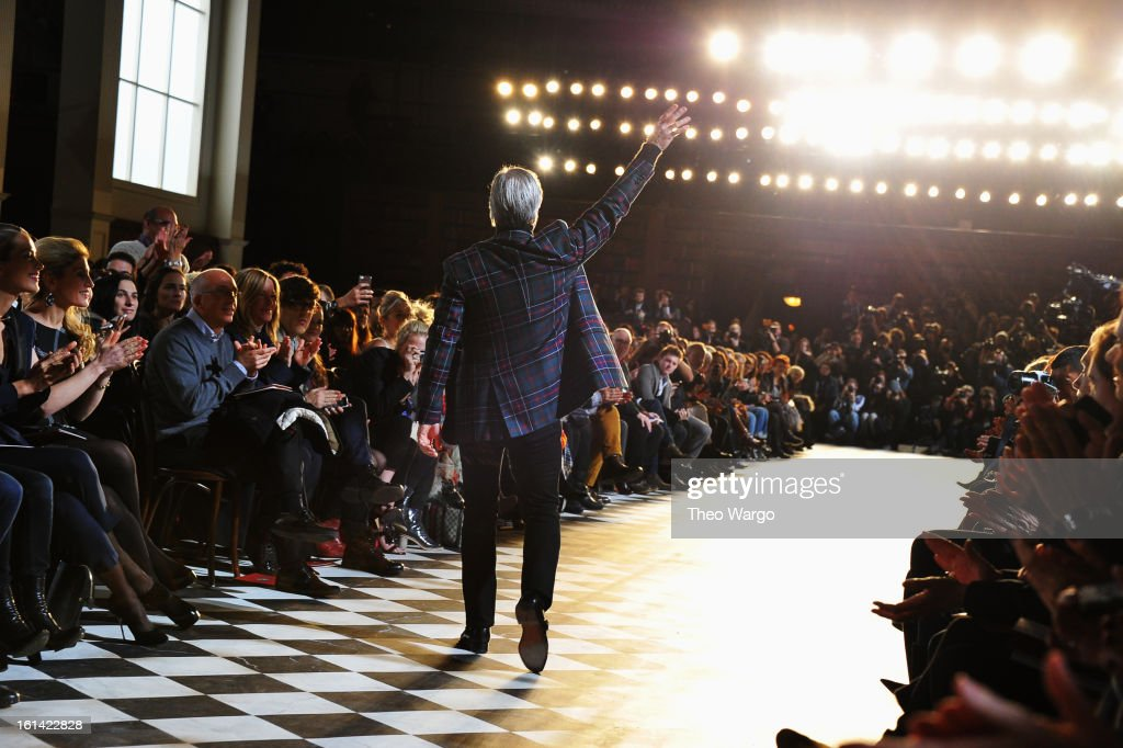 Designer Tommy Hilfiger walks the runway at the Tommy Hilfiger Fall 2013 Women's Collection fashion show during Mercedes-Benz Fashion Week at the Park Avenue Armory on February 10, 2013 in New York City.