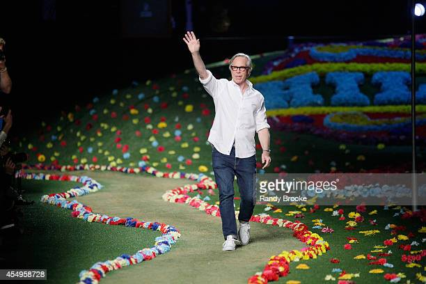 Designer Tommy Hilfiger walks the runway at Tommy Hilfiger Women's fashion show during MercedesBenz Fashion Week Spring 2015 at Park Avenue Armory on...
