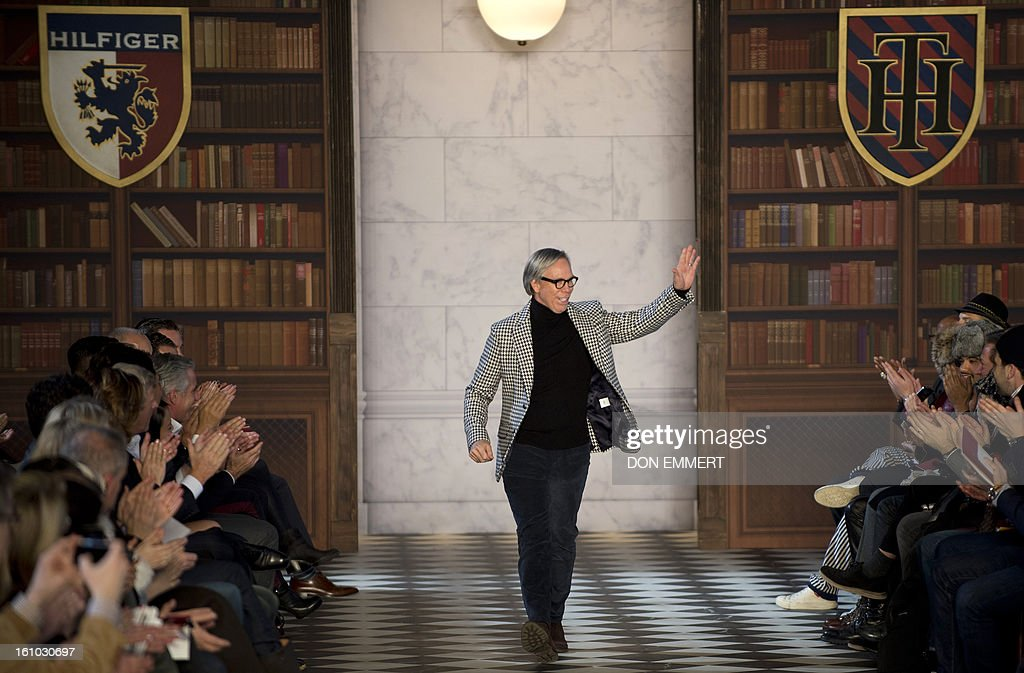 Designer Tommy Hilfiger waves to the crowd after his show at the Mercedes-Benz fashion week February 8, 2013 in New York.