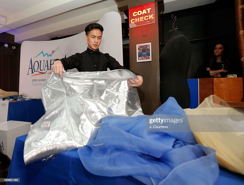 Designer Tony Vo works on his design during the Aquafina 'Pure Challenge' at the Aquafina 'Pure Challenge' After Party at The Empire Hotel Rooftop on February 6, 2013 in New York City.
