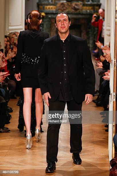Designer Tony Ward aknowledges the public after his show show as part of Paris Fashion Week Haute Couture Spring/Summer 2014 on January 20 2014 in...