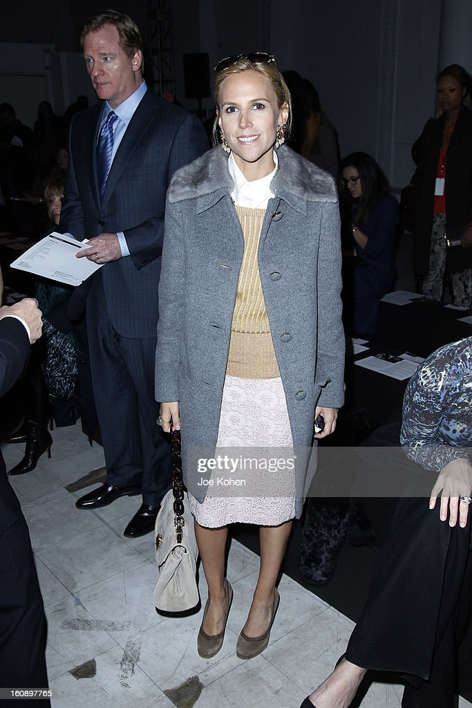 Designer Tory Burch (C) and NFL Commissioner <a gi-track='captionPersonalityLinkClicked' href=/galleries/search?phrase=Roger+Goodell&family=editorial&specificpeople=744758 ng-click='$event.stopPropagation()'>Roger Goodell</a> (L) attend the Kimberly Ovitz show during Fall 2013 Mercedes-Benz Fashion Week at Cafe Rouge on February 7, 2013 in New York City.