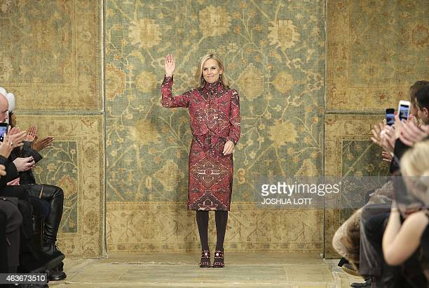 Designer Tory Burch stands on the runway as she waves to guests after showing her Fall/Winter collection during New York Fashion Week February 17...
