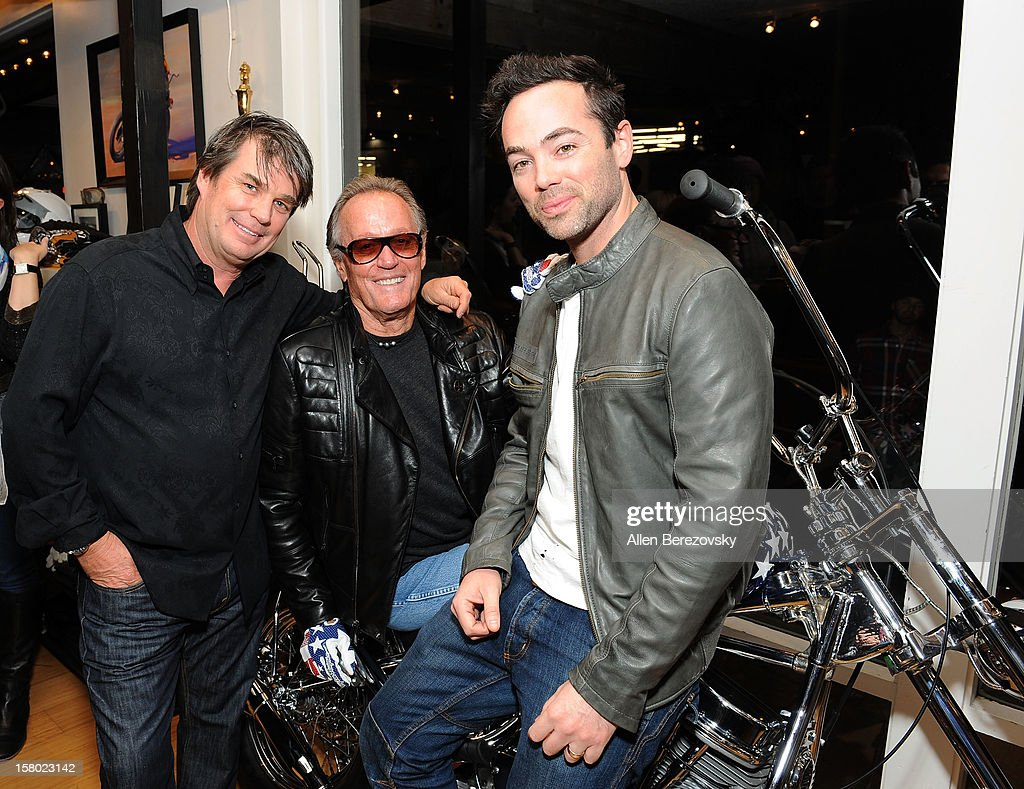 Designer Troy Lee, actor Peter Fonda and actor John Hensley attend the launch of Peter Fonda's new men's fashion line and protective riding gear collection for Troy Lee Designs at Troy Lee Boutique & Design Center on December 8, 2012 in Laguna Beach, California.