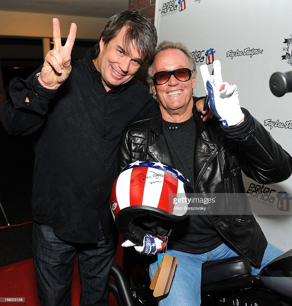Designer Troy Lee (L) and actor <a gi-track='captionPersonalityLinkClicked' href=/galleries/search?phrase=Peter+Fonda&family=editorial&specificpeople=213498 ng-click='$event.stopPropagation()'>Peter Fonda</a> attend the launch of <a gi-track='captionPersonalityLinkClicked' href=/galleries/search?phrase=Peter+Fonda&family=editorial&specificpeople=213498 ng-click='$event.stopPropagation()'>Peter Fonda</a>'s new men's fashion line and protective riding gear collection for Troy Lee Designs at Troy Lee Boutique & Design Center on December 8, 2012 in Laguna Beach, California.