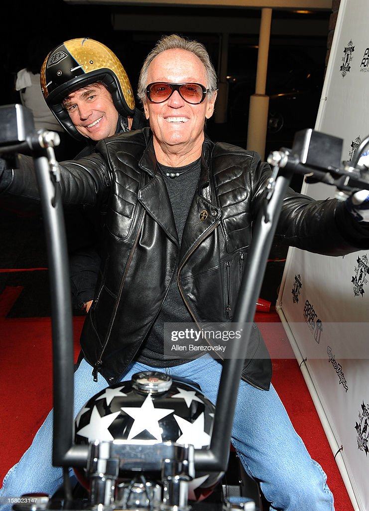 Designer Troy Lee (L) and actor Peter Fonda attend the launch of Peter Fonda's new men's fashion line and protective riding gear collection for Troy Lee Designs at Troy Lee Boutique & Design Center on December 8, 2012 in Laguna Beach, California.