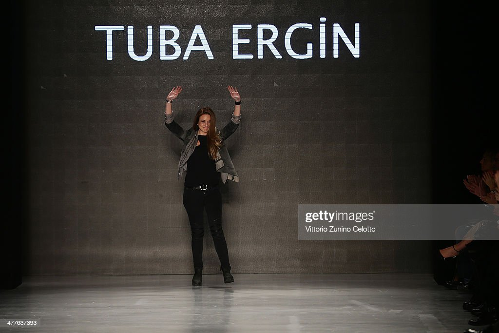 Designer Tuba Ergin appears at the end of the runway after the Tuba Ergin show during MBFWI presented by American Express Fall/Winter 2014 on March 10, 2014 in Istanbul, Turkey.