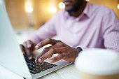 Hands of businessman or designer typing on l aptop