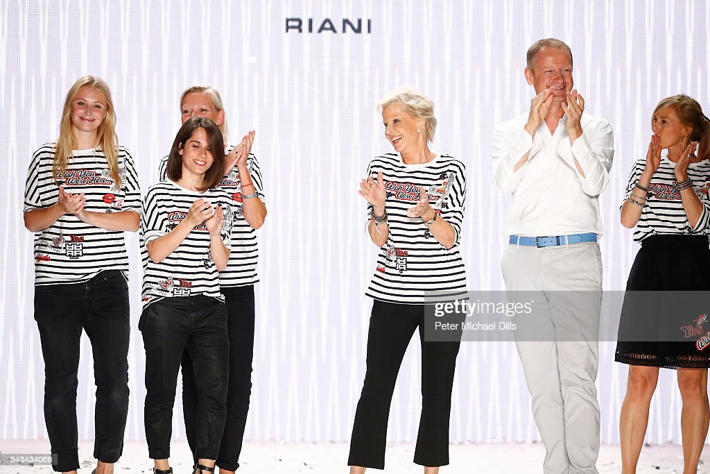 Designer Ulrich Schulte and models acknowledge the applause of the audience at the Riani show during the Mercedes-Benz Fashion Week Berlin Spring/Summer 2017 at Erika Hess Eisstadion on June 28, 2016 in Berlin, Germany.