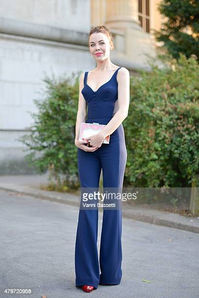 Designer Ulyana Sergeenko poses wearing an Ulyana Sergeenko dress and clutch after the Giambattista Valli show at the Grand Palais on July 6 2015 in...
