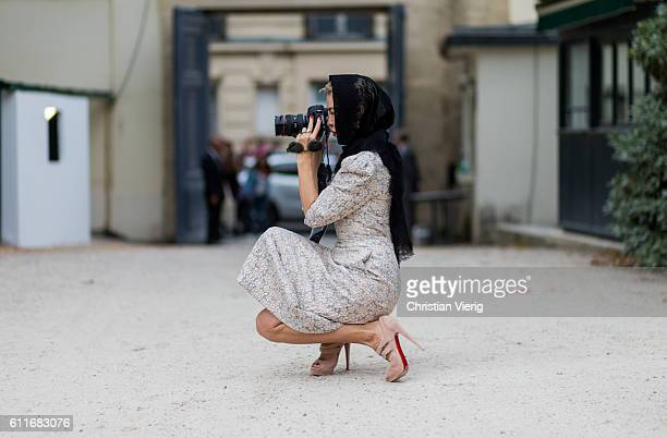 Designer Ulyana Sergeenko taking photos with her Canon Mark III camera outside Dior on September 30 2016 in Paris France