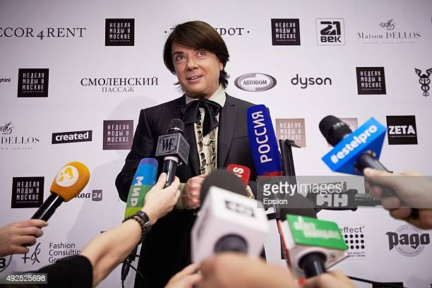 Designer Valentin Yudashkin speaks with journalists before his show during Moscow Fashion Week at Gostiny Dvor on October 13 2015 in Moscow Russia