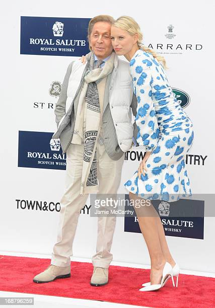 Designer Valentino Garavani and Model Karolina Kurkova attend the Sentebale Royal Salute Polo Cup during the sixth day of HRH Prince Harry's visit to...
