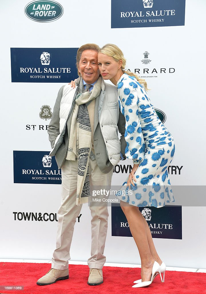 Designer <a gi-track='captionPersonalityLinkClicked' href=/galleries/search?phrase=Valentino+Garavani+-+Fashion+Designer&family=editorial&specificpeople=4297414 ng-click='$event.stopPropagation()'>Valentino Garavani</a> and Model <a gi-track='captionPersonalityLinkClicked' href=/galleries/search?phrase=Karolina+Kurkova&family=editorial&specificpeople=202513 ng-click='$event.stopPropagation()'>Karolina Kurkova</a> attend the Sentebale Royal Salute Polo Cup at The Greenwich Polo Club on Wednesday 15th May. The Sentebale Land Rover team was captained by Royal Salute Ambassador Malcom Borwick with team members Mark Ganzi, Michael Carrazza and Prince Harry, one of the founding Patrons of Sentebale. The St. Regis polo team was captained by Sentebale's Ambassador Nacho Figueras with team members Peter Orthwein, Steve Lefkowitz and Dawn Jones. Royal Salute played host to a number of high profile celebrities. Royal Salute World Polo is a global programme, which now supports tournaments across four continents. The luxury Scotch's involvement with Polo is founded on the game's incredible power, skill and elegance; qualities which blend perfectly with Royal Salute Scotch Whisky, at Greenwich Polo Club on May 15, 2013 in Greenwich, Connecticut.
