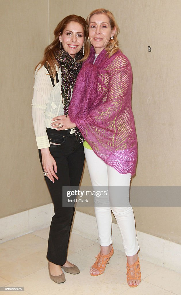 Designer Valerie Mouawad (in pink) of Norma Ishak poses with models at the Made In The USA 2013 Fashion Presentation at the Carlton Hotel on April 23, 2013 in New York City.