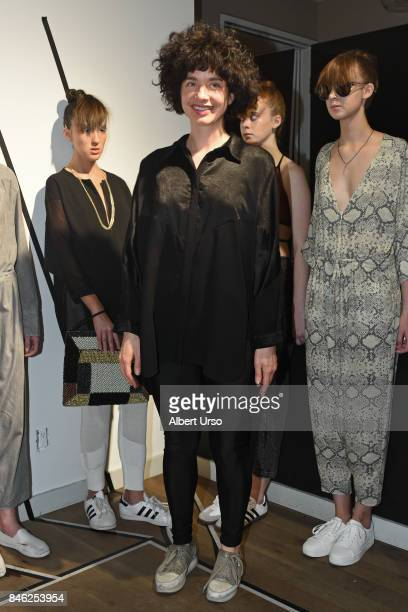 Designer Veronika Brusa poses with models at the Berenik presentation during New York Fashion Week on September 12 2017 in New York City