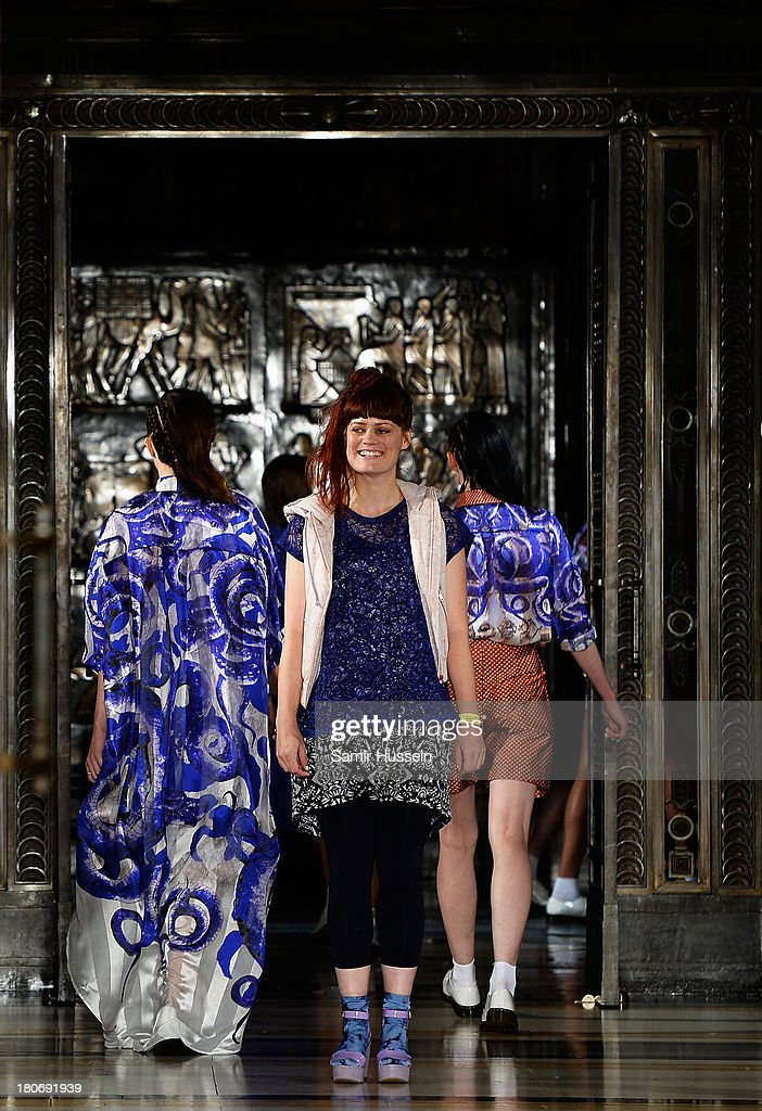 Designer Vibe Lundemark acknowledges the audience following the Tabernacle Twins show during at the Fashion Scout venue during London Fashion Week SS14 at Freemasons Hall on September 16, 2013 in London, England.
