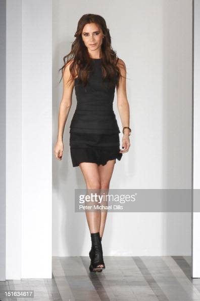Designer Victoria Beckham poses on the runway at the Victoria Beckham Spring 2013 presentation during MercedesBenz Fashion Week at New York Public...