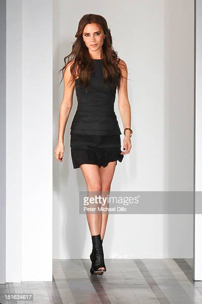 Designer Victoria Beckham poses on the runway at the Victoria Beckham Spring 2013 presentation during MercedesBenz Fashion Week at New York Public...