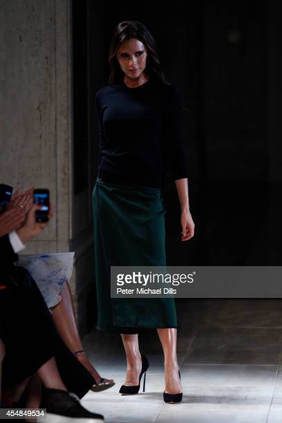 Designer Victoria Beckham walks the runway at the Victoria Beckham fashion show during MercedesBenz Fashion Week Spring 2015 at The Cunard Building...