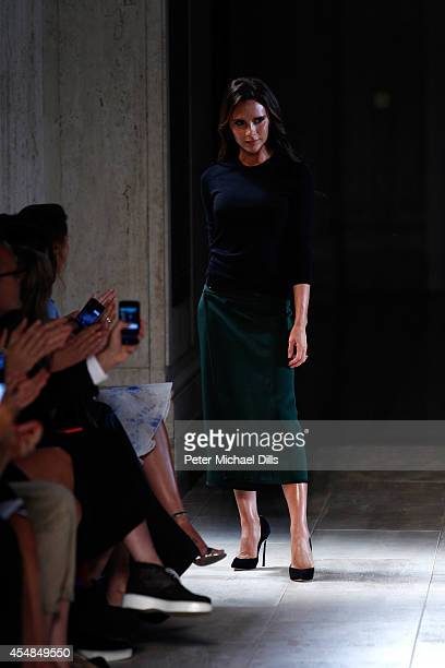 Designer Victoria Beckham walks the runway at the Victoria Beckham fashion show during MercedesBenz Fashion Week Spring 2015 at The Cunard Building...