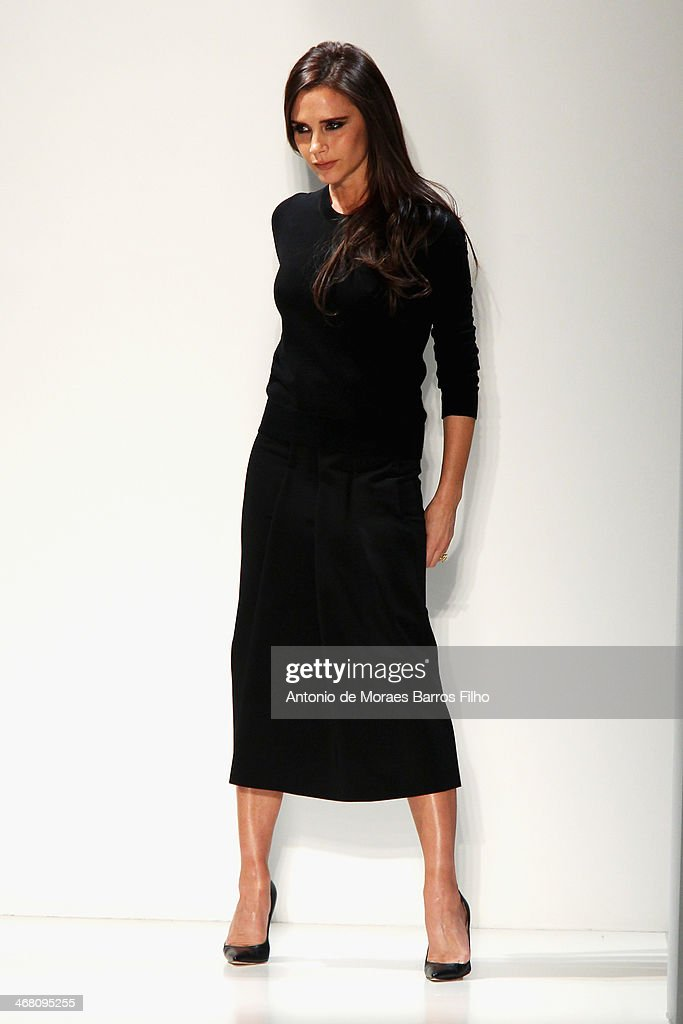Designer <a gi-track='captionPersonalityLinkClicked' href=/galleries/search?phrase=Victoria+Beckham&family=editorial&specificpeople=161100 ng-click='$event.stopPropagation()'>Victoria Beckham</a> walks the runway at the <a gi-track='captionPersonalityLinkClicked' href=/galleries/search?phrase=Victoria+Beckham&family=editorial&specificpeople=161100 ng-click='$event.stopPropagation()'>Victoria Beckham</a> presentation during Mercedes-Benz Fashion Week Fall 2014 at Cafe Rouge on February 9, 2014 in New York City.
