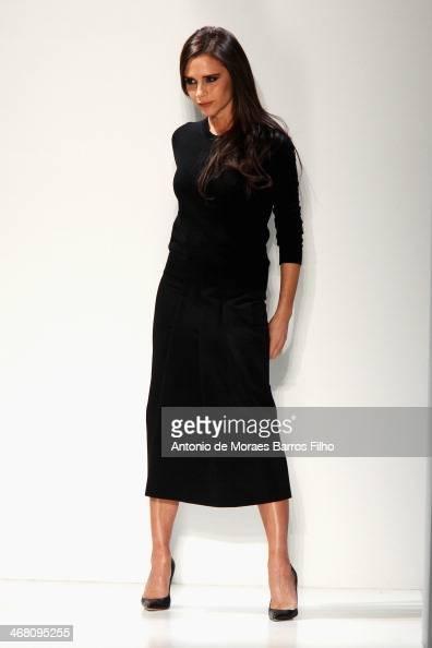 Designer Victoria Beckham walks the runway at the Victoria Beckham presentation during MercedesBenz Fashion Week Fall 2014 at Cafe Rouge on February...