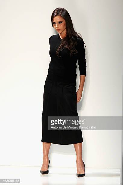 Designer Victoria Beckham walks the runway at the Victoria Beckham presentation during MercedesBenz Fashion Week Fall 2014 at Cafe Rouge on February...