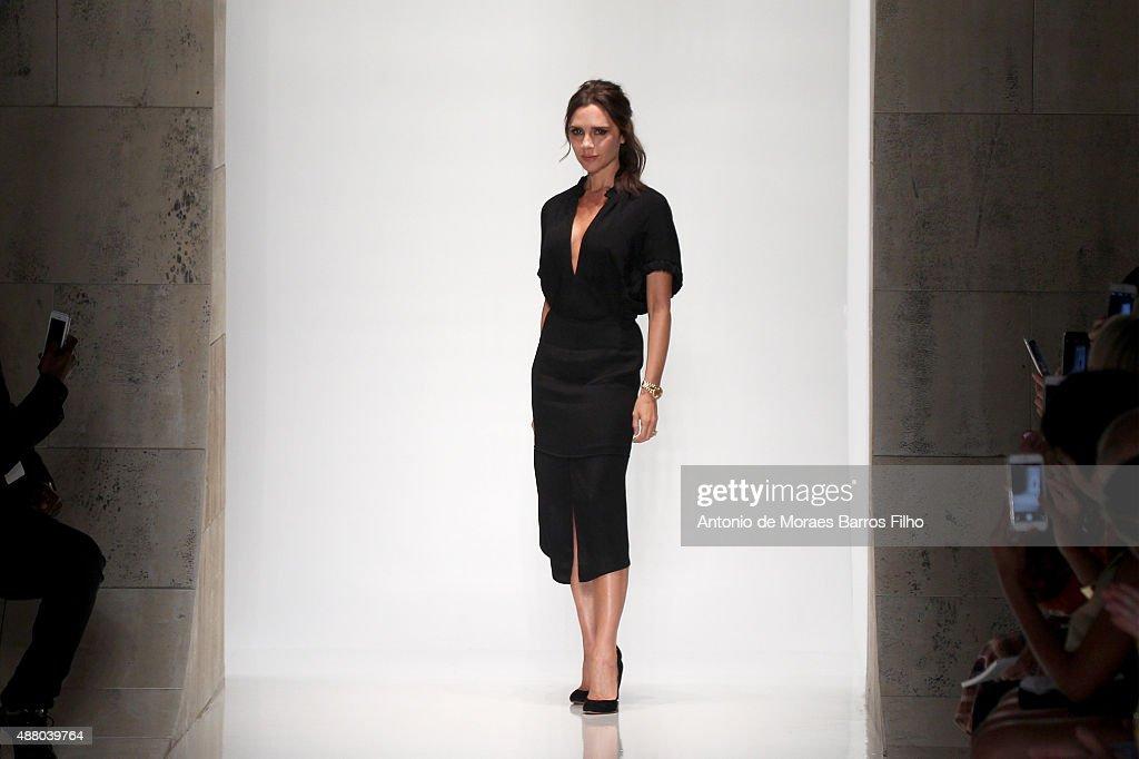 Designer Victoria Beckham walks the runway wearing ...