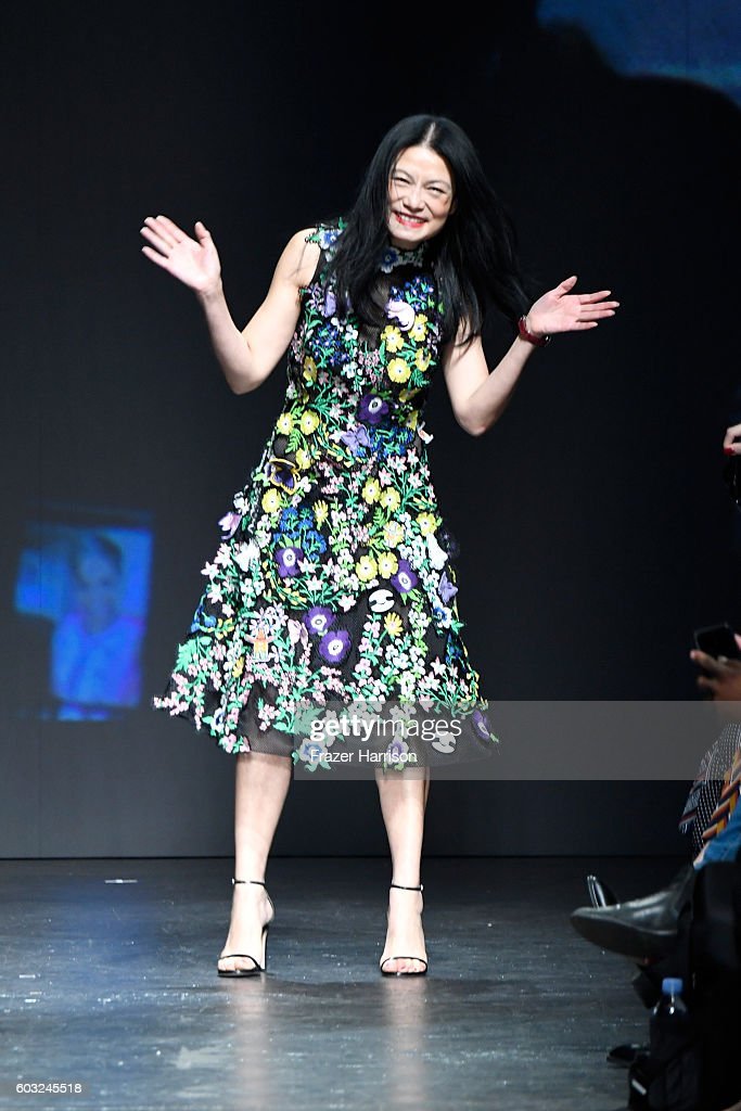 Designer Vivienne Tam takes a bow on the runway at the Vivienne Tam fashion show during New York Fashion Week: The Shows at The Arc, Skylight at Moynihan Station on September 12, 2016 in New York City.