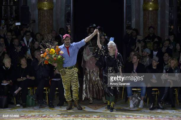 Designer Vivienne Westwood acknowledges the audience with Andreas Kronthaler during the Vivienne Westwood show as part of Paris Fashion Week...