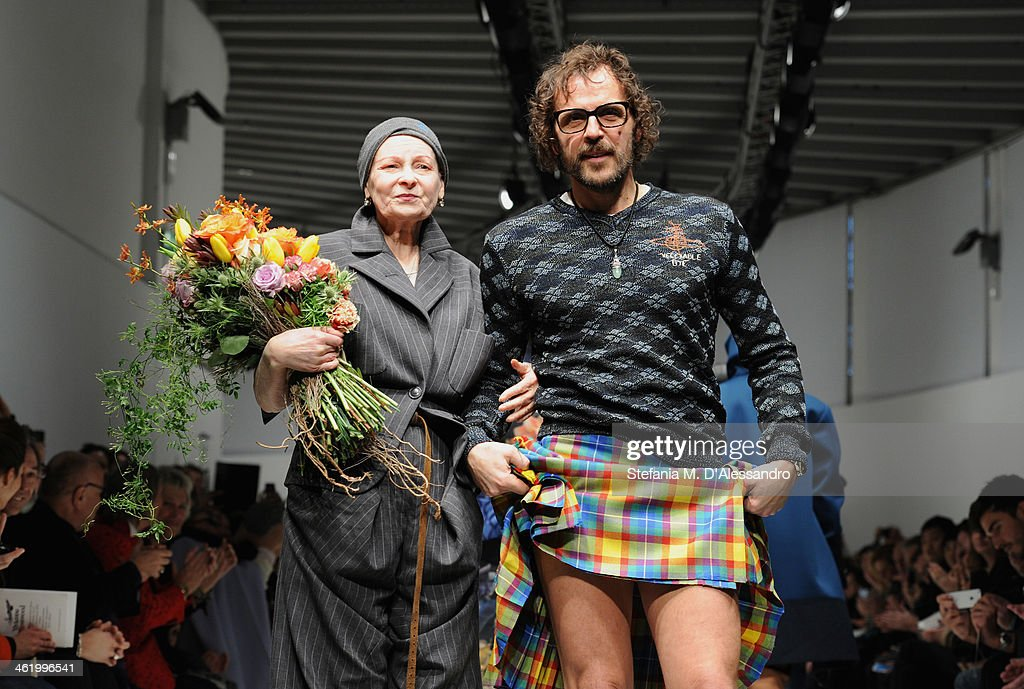 Designer Vivienne Westwood and Andreas Kronthaler acknowlledge the applause of the audience after the Vivienne Westwood show as a part of Milan...