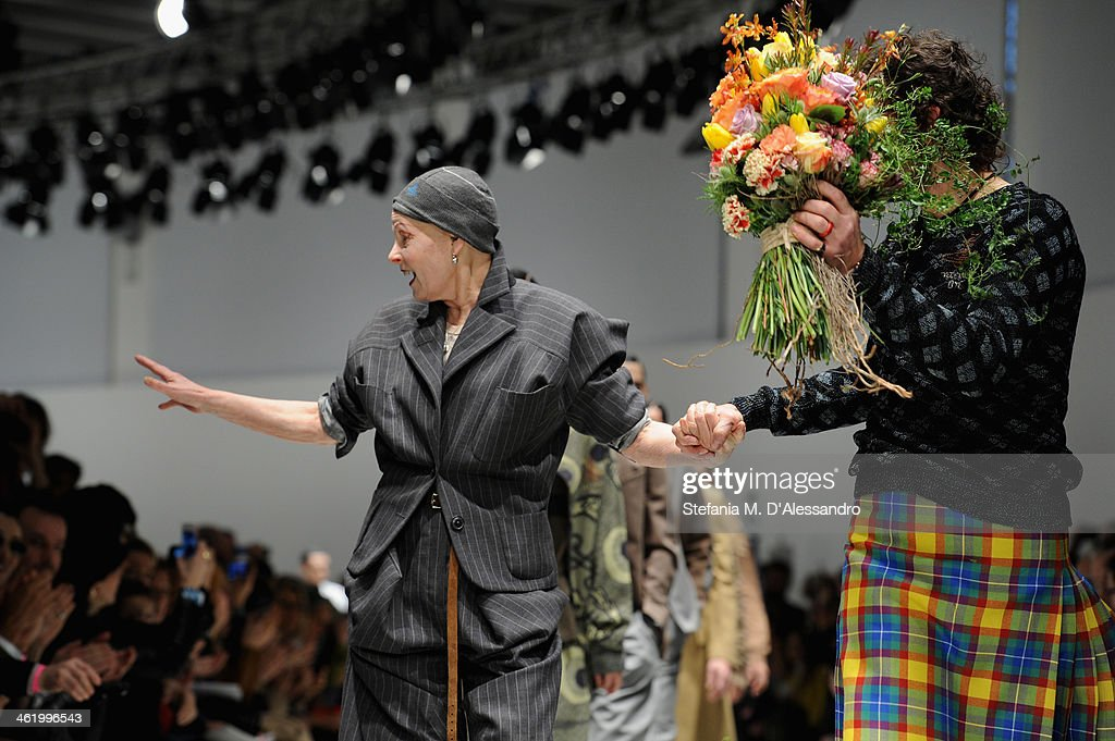 Designer <a gi-track='captionPersonalityLinkClicked' href=/galleries/search?phrase=Vivienne+Westwood+-+Fashion+Designer&family=editorial&specificpeople=853100 ng-click='$event.stopPropagation()'>Vivienne Westwood</a> and Andreas Kronthaler acknowlledge the applause of the audience after the <a gi-track='captionPersonalityLinkClicked' href=/galleries/search?phrase=Vivienne+Westwood+-+Fashion+Designer&family=editorial&specificpeople=853100 ng-click='$event.stopPropagation()'>Vivienne Westwood</a> show as a part of Milan Fashion Week Menswear Autumn/Winter 2014 on January 12, 2014 in Milan, Italy.