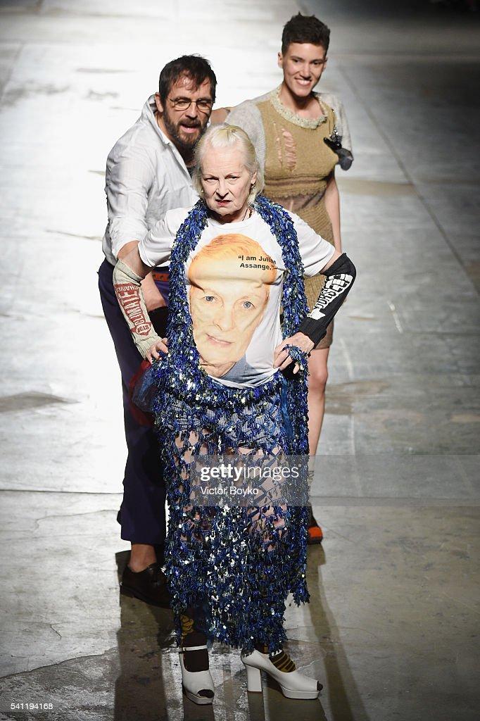 Designer Vivienne Westwood Andreas Kronthaler and model walk the runway at the Vivienne Westwood show during Milan Men's Fashion Week Spring/Summer...