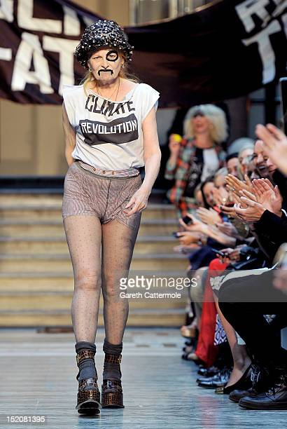 Designer Vivienne Westwood walks on the catwalk by Vivienne Westwood Red Label on day 3 of London Fashion Week Spring/Summer 2013 at the British...