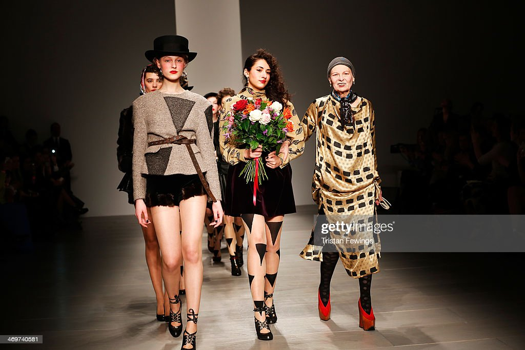 Designer Vivienne Westwood walks with models on the runway after the Vivienne Westwood Red Label show at London Fashion Week AW14 at on February 16...