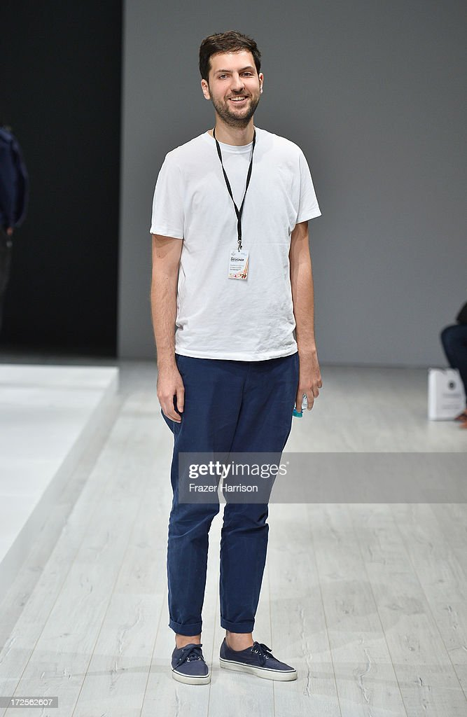 Designer Vladimir Karaleev poses at his show during Mercedes-Benz Fashion Week Spring/Summer 2014 at Brandenburg Gate on July 3, 2013 in Berlin, Germany.