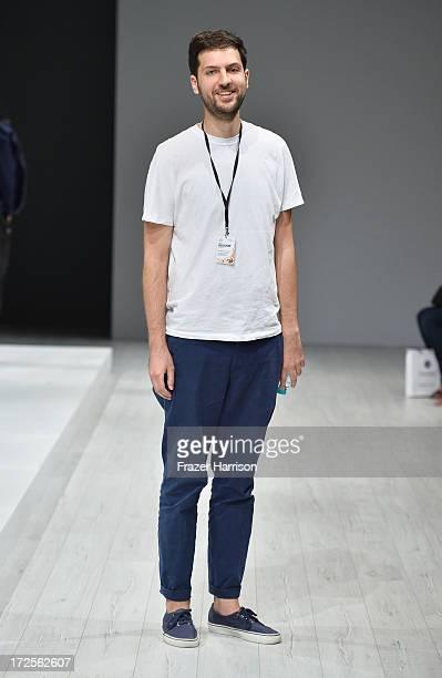 Designer Vladimir Karaleev poses at his show during MercedesBenz Fashion Week Spring/Summer 2014 at Brandenburg Gate on July 3 2013 in Berlin Germany