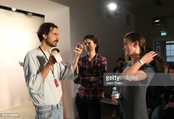Designer Vladimir Karaleev talks to his team backstage ahead of his show during the MercedesBenz Fashion Week Berlin Spring/Summer 2018 at Kaufhaus...