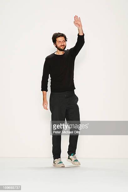 Designer Vladimir Karaleev walks the runway at Vladimir Karaleev Autumn/Winter 2013/14 fashion show during MercedesBenz Fashion Week Berlin at...