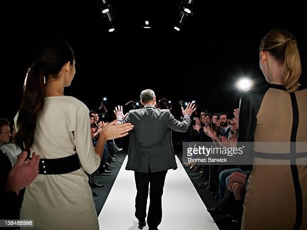 Designer walking onto catwalk at fashion show