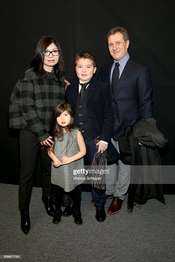 Designer Wang Tao, daughter, Victoria, son, Alex, and Tom Rodgers pose backstage at the Taoray Wang show during Fall 2016 New York Fashion Week: The Shows at The Dock, Skylight at Moynihan Station on February 13, 2016 in New York City.