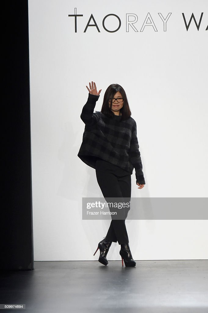 Designer Wang Tao greets the audience from the runway at Taoray Wang Fall 2016 during New York Fashion Week: The Shows at The Dock, Skylight at Moynihan Station on February 13, 2016 in New York City.