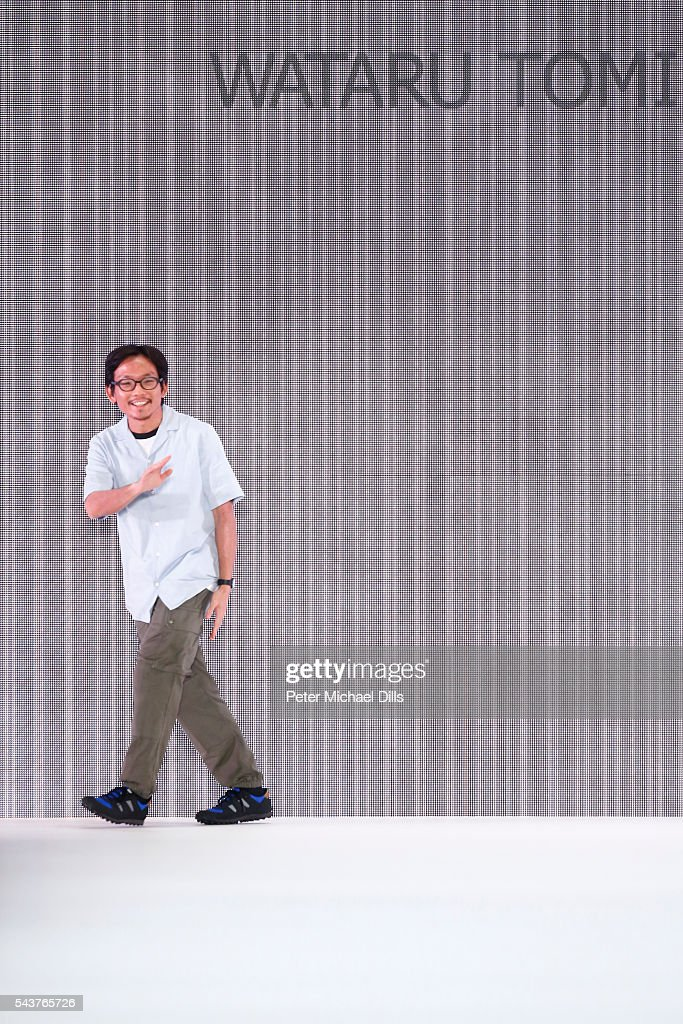 Designer Wataru Tominaga walks the runway after the his show presented by Mercedes-Benz & Elle show during the Mercedes-Benz Fashion Week Berlin Spring/Summer 2017 at Erika Hess Eisstadion on June 30, 2016 in Berlin, Germany.