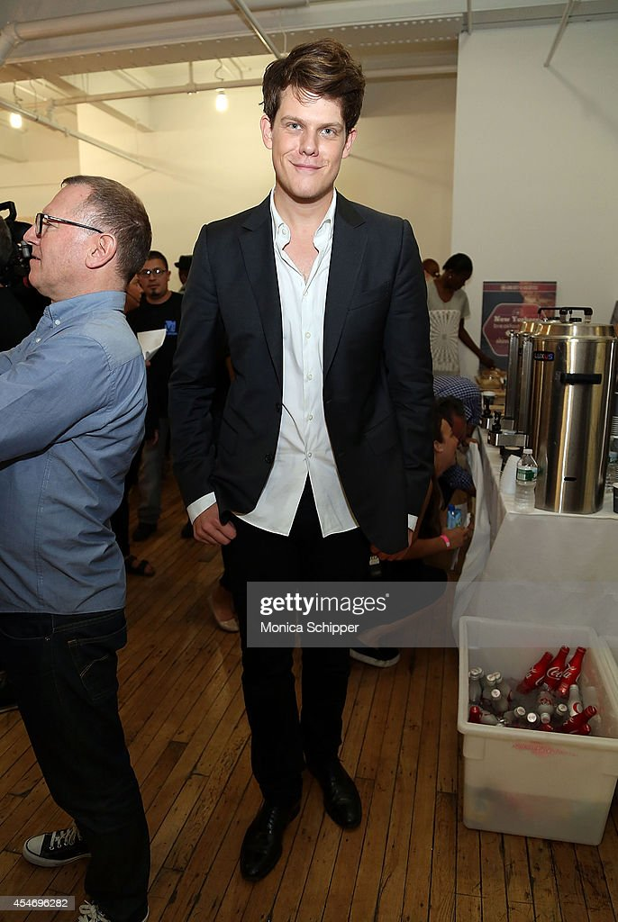Designer Wes Gordon poses for a photo backstage at the Wes Gordon fashion show during MercedesBenz Fashion Week Spring 2015 at Highline Stages on...