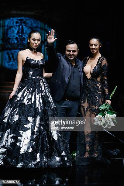 Designer Willfredo Gerardo walks with models down the runway during Art Hearts Fashion Show September 2016 during New York Fashion Week The Shows on...