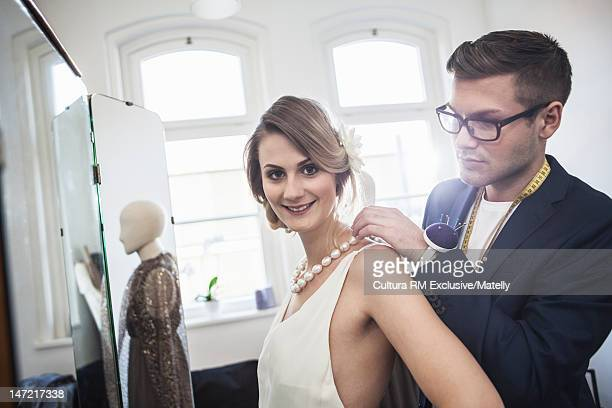 Designer with dressmaker in studio