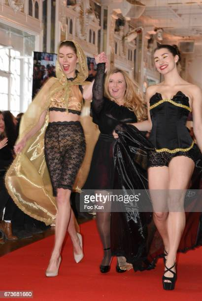 A designer with his models walk the runway during 'Fashion Night Couture 2017' Show at Salon des Miroirs on April 26 2017 in Paris France