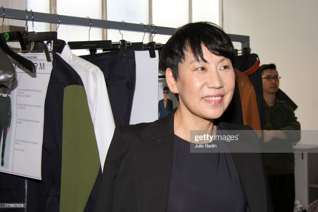 Designer <a gi-track='captionPersonalityLinkClicked' href=/galleries/search?phrase=Wooyoungmi&family=editorial&specificpeople=4823501 ng-click='$event.stopPropagation()'>Wooyoungmi</a> smiles backstage before the <a gi-track='captionPersonalityLinkClicked' href=/galleries/search?phrase=Wooyoungmi&family=editorial&specificpeople=4823501 ng-click='$event.stopPropagation()'>Wooyoungmi</a> Men Menswear Spring/Summer 2014 Show As Part Of The Paris Fashion Week on June 27, 2013 in Paris, France.